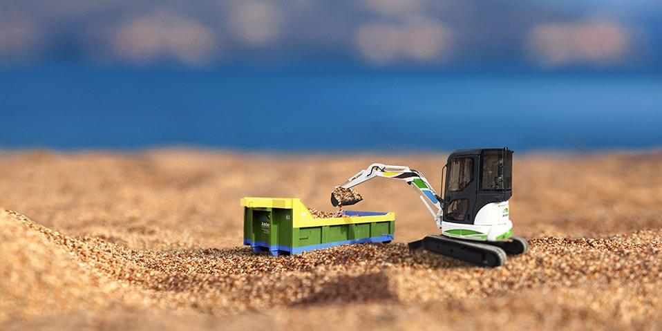 Blue gift box on a beach